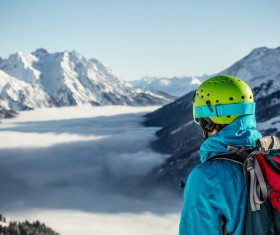 Watching the distant snow-capped mountain climbing men Stock Photo