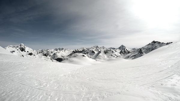 White snow covering mountain landscape Stock Photo
