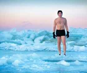 Winter swimming man Stock Photo