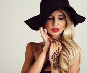 With black hat tattooed woman Stock Photo