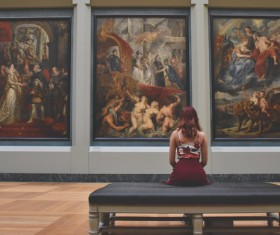 Woman admiring oil painting Stock Photo