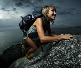 Woman climbing by hand Stock Photo