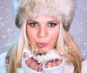 Woman holding snowflake in hand Stock Photo