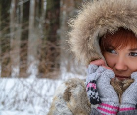 Woman in fur coat outdoors in winter Stock Photo