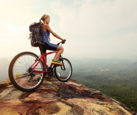 Woman riding a mountain bike looks into the distance Stock Photo 01