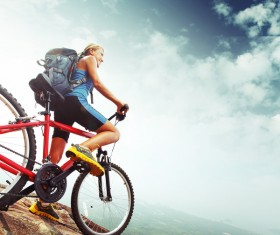 Woman riding a mountain bike looks into the distance Stock Photo 02