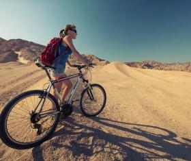 Woman riding mountain bike trip Stock Photo 01