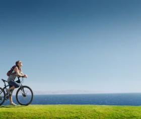 Woman riding mountain bike trip Stock Photo 02