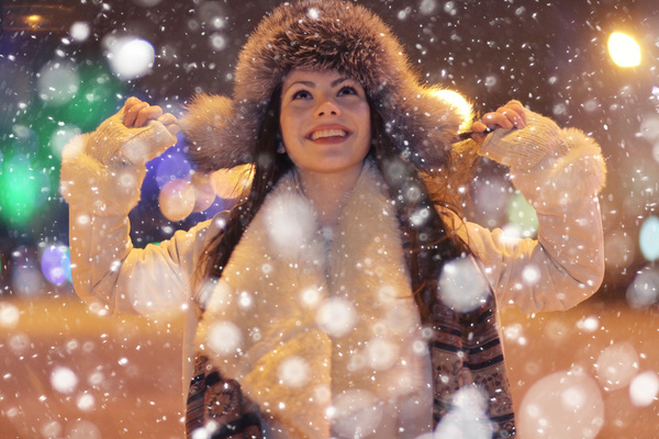 Woman wearing cotton cap outdoors in winter Stock Photo 03