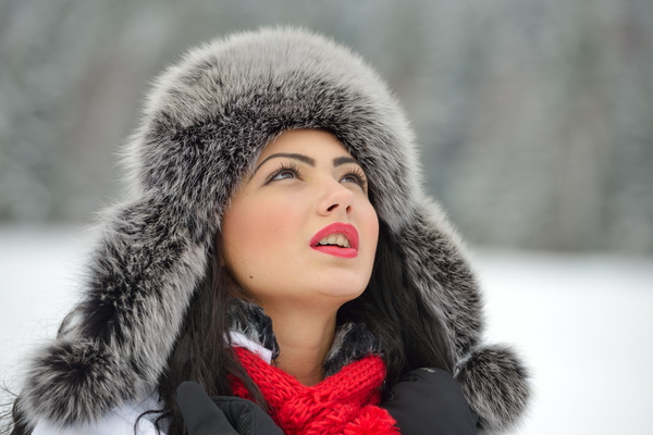 Woman wearing cotton cap outdoors in winter Stock Photo 04