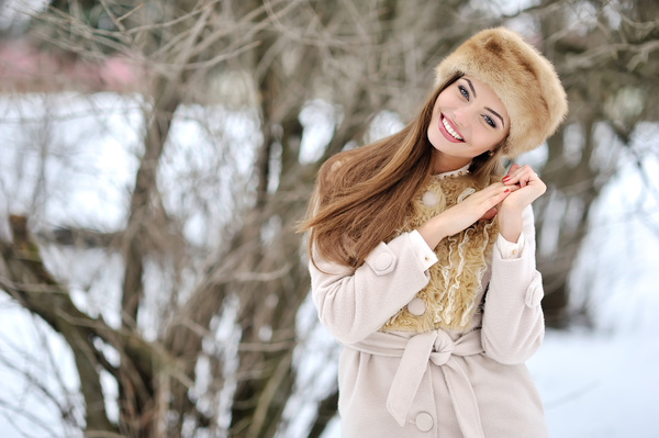 Woman wearing cotton cap outdoors in winter Stock Photo 06