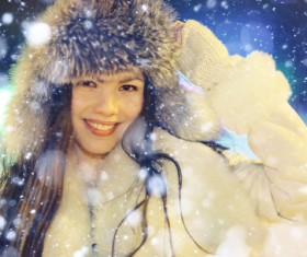 Woman wearing cotton cap outdoors in winter Stock Photo 07