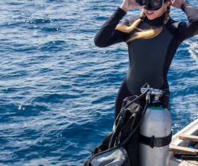 Woman wearing diving equipment Stock Photo