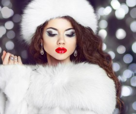 Woman with heavy makeup is wearing fur coat Stock Photo