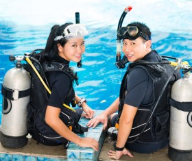 Young Lovers wearing wetsuit Stock Photo