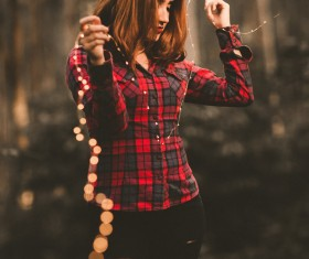 Young girl holding shiny lights Stock Photo