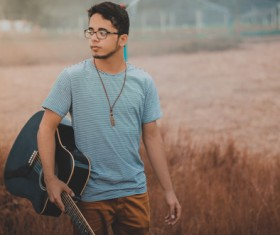 Young man holding guitar Stock Photo