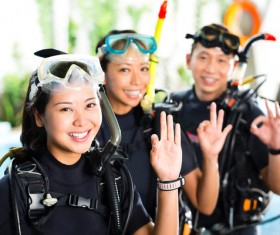 Young people dressed in diving suits Stock Photo