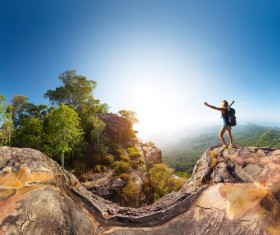 happy woman on the top of the hill Stock Photo