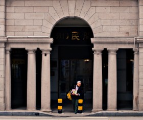 man walking in front of classical building Stock Photo