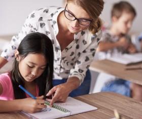 teacher instructing pupil to spell Stock Photo