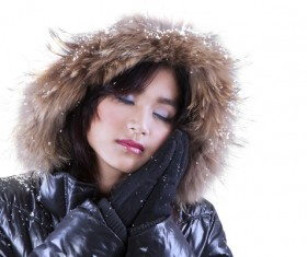 wearing down jacket Woman Stock Photo