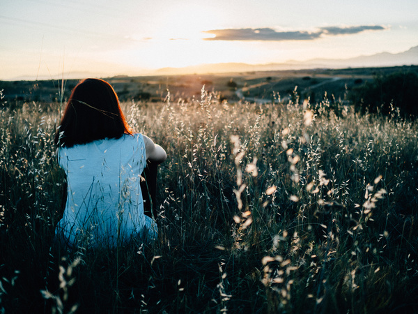 woman relaxing on wild flowers meadow Stock Photo