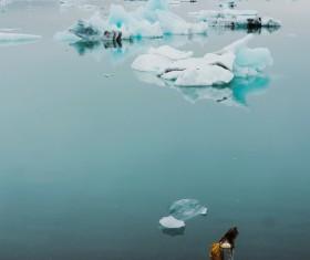 woman walking on frozen beach scene Stock Photo