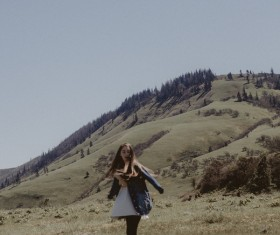 young woman posing on hill Stock Photo