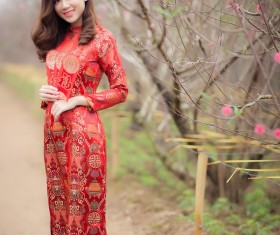 Beautiful asian girl in red festive costume Stock Photo