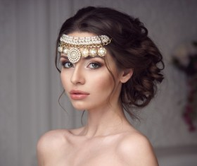 Beautiful girl wearing pearl headdress Stock Photo