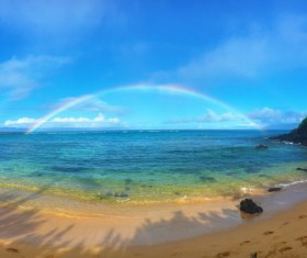 Beautiful rainbow over the sea Stock Photo
