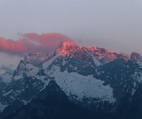 Beautiful snowy rocky mountain peak Stock Photo