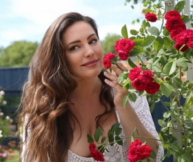 Beautiful woman smells of flowers Stock Photo