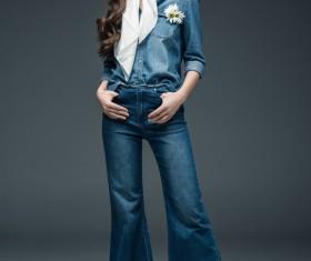 Beautiful woman wearing denim suit Stock Photo 02