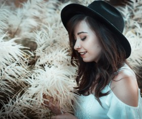 Beautiful young lady posing by wild flowers Stock Photo