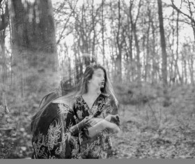 Black white picture of woman in forest Stock Photo