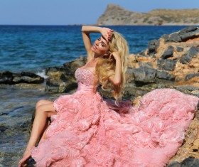 Blonde in pink dress by the sea Stock Photo 01