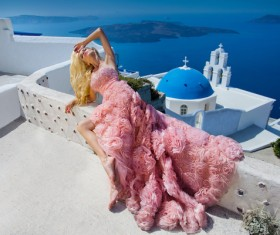 Blonde in pink dress by the sea Stock Photo 02