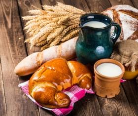 Bread wheat and milk on the desktop Stock Photo 01