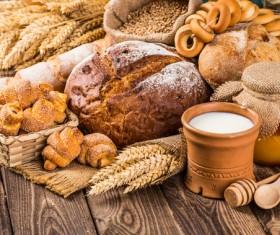 Bread wheat and milk on the desktop Stock Photo 02