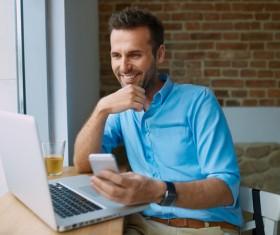 Casual man relaxing using laptop Stock Photo 05