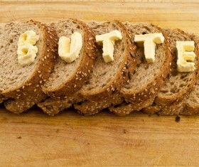 Cheese letters and slices of bread Stock Photo