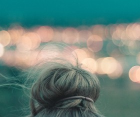 Closeup of woman hairstyle and bokeh lights Stock Photo