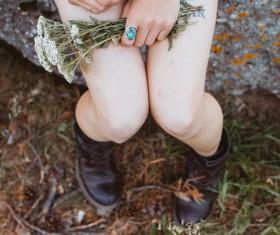 Closeup woman holding wild flowers Stock Photo