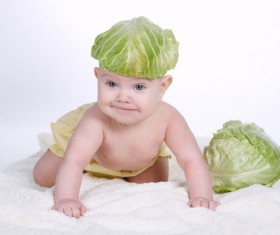 Cute baby and vegetables Stock Photo