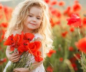 Cute little girl holding flowers Stock Photo