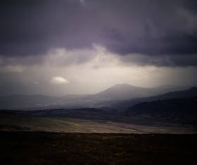 Dark clouds above empty highland Stock Photo
