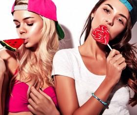 Eating lollipop girl Stock Photo