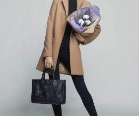 Fashionable woman receiving flowers Stock Photo 02